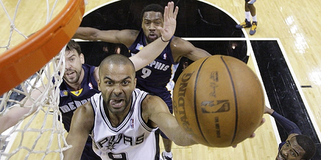 April 20: San Antonio Spurs' Tony Parker (9), of France, drives to the basket as Memphis Grizzlies' Marc Gasol, left, of Spain, Tony Allen (9) and Mike Conley, right, defend during the first quarter of Game 2 of a first-round NBA basketball playoff series in San Antonio.