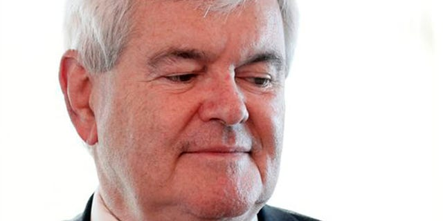FILE -- April 12, 2012: Newt Gingrich pauses after a being a guest on a radio interview in the Hollywood Diner in Dover, Del.
