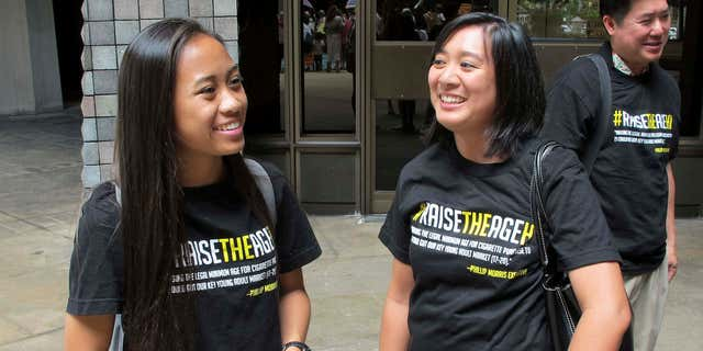 April 24, 2015: Sabrina Olaes, left, a high school senior who supports raising the legal smoking age, reacts with Lyndsey Garcia, center, of the Coalition for a Tobacco-Free Hawaii and Cory Chun of the American Cancer Society Cancer Action Network outside the Hawaii Legislature after it passed a bill to raise the legal smoking age to 21.