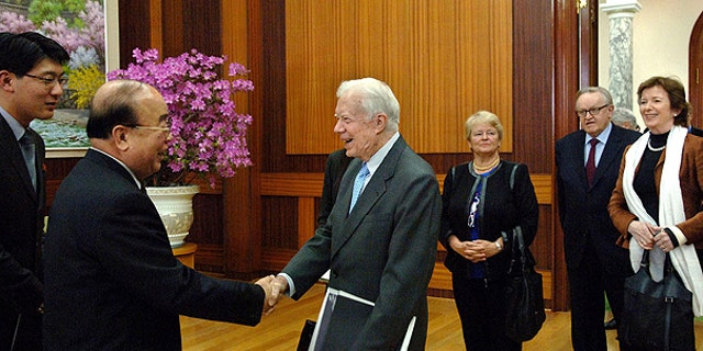 April 26: n this photo released by Korean Central News Agency via Korea News Service in Tokyo, former U.S. President Jimmy Carter, center, is greeted by Pak Ui Chun, second left, North Korea's foreign minister, in the Paekhwawon state guesthouse in Pyongyang, North Korea.