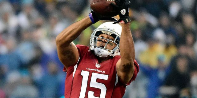 Jan 3, 2015; Charlotte, NC, USA; Arizona Cardinals wide receiver Michael Floyd (15) catches a pass over Carolina Panthers cornerback Josh Norman (24) during the first quarter in the 2014 NFC Wild Card playoff football game at Bank of America Stadium. Mandatory Credit: Bob Donnan-USA TODAY Sports