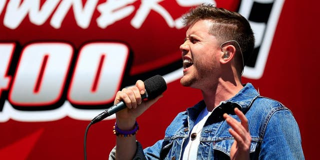 RICHMOND, VA - APRIL 24: Country music singer and American Idol winner Trent Harmon performs the national anthem prior to the NASCAR Sprint Cup Series TOYOTA OWNERS 400 at Richmond International Raceway on April 24, 2016 in Richmond, Virginia. (Photo by Daniel Shirey/NASCAR via Getty Images)