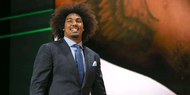 CHICAGO, IL - APRIL 30: Leonard Williams of the USC Trojans walks on stage after being chosen #6 overall by the New York Jets during the first round of the 2015 NFL Draft at the Auditorium Theatre of Roosevelt University on April 30, 2015 in Chicago, Illinois. (Photo by Jonathan Daniel/Getty Images)