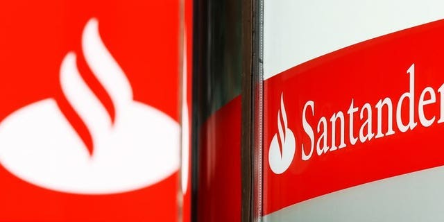 Police said they have charged four men over a plot to remotely take control of a computer at a branch of Santander bank and steal millions of pounds