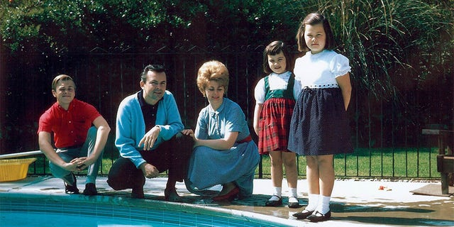 Robert, Bob, Anne, Karen, and Debbie Crane poolside, 1964.