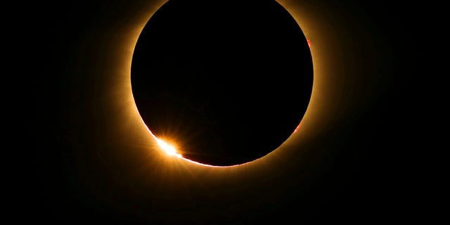The moon passes in front of the sun for a total solar eclipse visible from Farmington, Mo., Monday, Aug. 21, 2017 in Farmington, Mo. (Anthony Souffle/Star Tribune via AP)