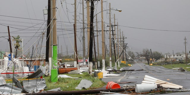 Debris and damaged electrical installations are seen after the area was hit by Hurricane Maria en Guayama, Puerto Rico September 20, 2017.