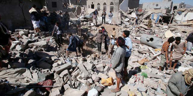 May 1, 2015: People search for survivors under the rubble of houses destroyed by Saudi-led airstrikes in Sanaa, Yemen.