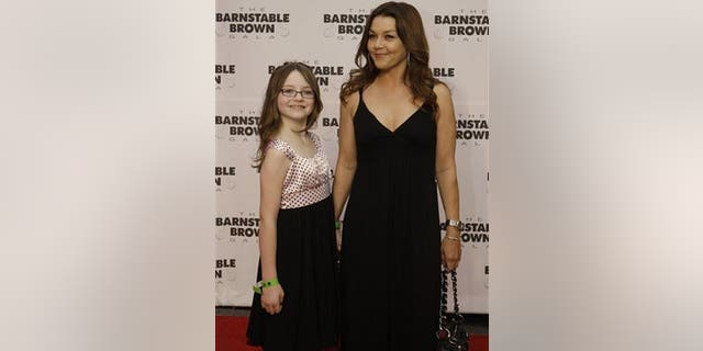 May 1: Gretchen Wilson and her daughter, Grace Frances Penner, arrive at the Barnstable Brown Derby party in Louisville, Ky.