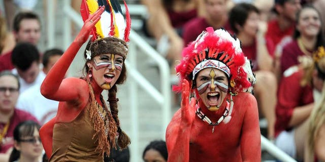 Sept 8, 2012; Tallahassee, Florida, USA; Florida State Seminoles fans cheer during the game against the Savannah State Tigers at Doak Campbell Stadium. Mandatory Credit: Melina Vastola-USA TODAY Sports