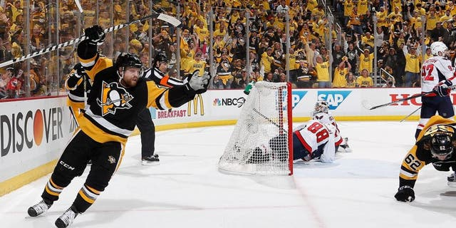 PITTSBURGH, PA - MAY 2: Phil Kessel #81 of the Pittsburgh Penguins celebrates a goal by Carl Hagelin #62 during the second period against the Washington Capitals in Game Three of the Eastern Conference Second Round during the 2016 NHL Stanley Cup Playoffs at Consol Energy Center on May 2, 2016 in Pittsburgh, Pennsylvania. (Photo by Gregory Shamus/NHLI via Getty Images)