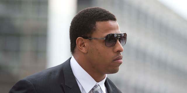 Feb. 9, 2015: Greg Hardy arrives at the Mecklenburg County Courthouse on the first day of his domestic violence appeal trial in Charlotte, N.C.