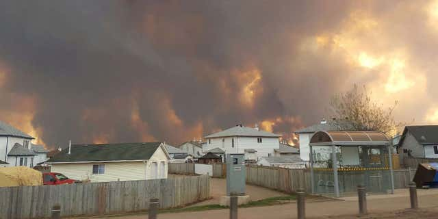 Smoke rises from a wildfire outside of Fort McMurray, Alberta.