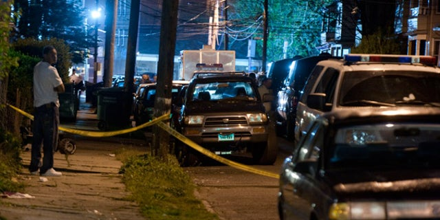 May 4: Police vehicles fill a street as officers search the home of the suspected Times Square bomber in Bridgeport, Conn.