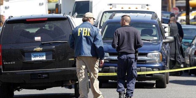 May 4: FBI personnel walk down the street of Pakistani-American Faisal Shahzad on Sheridan Street in Bridgeport, Connecticut.