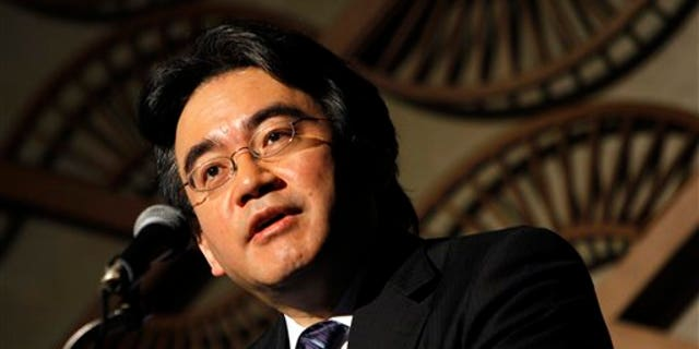 May 7: Nintendo Co. President Satoru Iwata speaks during a press briefing in Tokyo. Iwata said anti-piracy measures will be beefed up in its upcoming 3-D handheld gaming device. The Japanese game-maker of Super Mario and Pokemon has said it will unveil the new device at the E3 trade show in Los Angeles next month.