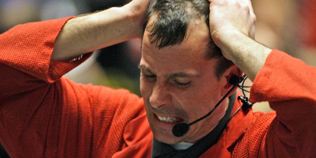 May 6: A trader reacts in the S&P 500 futures pit at the CME Group in Chicago near the close of trading.