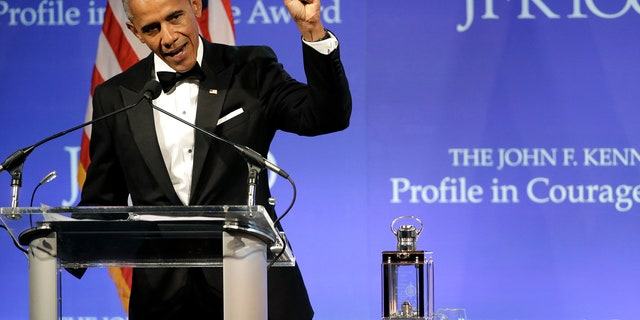 Former President Barack Obama speaks after being presented with the 2017 Profile in Courage award during ceremonies at the John F. Kennedy Presidential Library and Museum Sunday, May 7, 2017, in Boston. (AP Photo/Steven Senne)