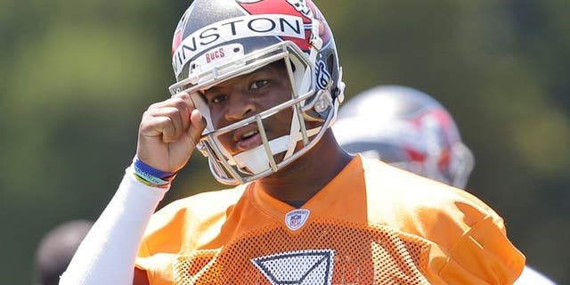 Tampa Bay Buccaneers quarterback Jameis Winston calls out a play during drills in an NFL rookie minicamp in Tampa, Fla., Friday, May 8, 2015. (AP Photo/Wilfredo Lee)