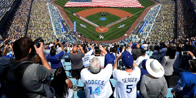 A former Los Angeles Dodgers front office employee, and Afghanistan war veteran, reportedly told Major League Baseball that he was discriminated against when his contract was up last year.