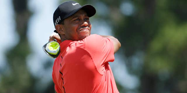 May 10, 2015: Tiger Woods hits from the 16 tee during the final round of The Players Championship golf tournament.