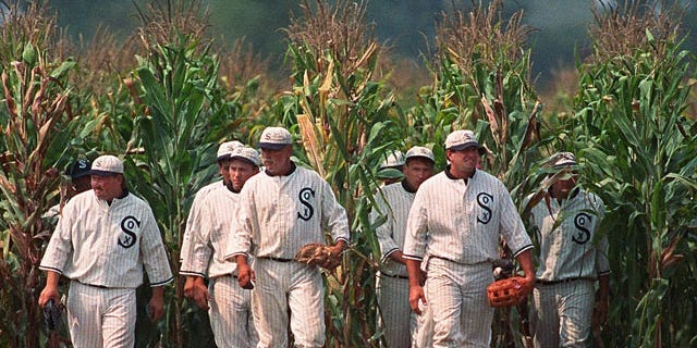 """In this June 22, 1997, file photo, Ghost Players emerge from the cornfield at the """"Field of Dreams"""" movie site in Dyersville, Iowa."""