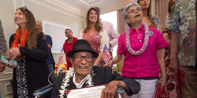 May 13, 2016: Alfonso Gonzales, 96, University of Southern California's oldest graduating Trojan receives his Bachelor of Science degree in zoology diploma from USC surrounded by family members, as part of the 2016 USC Commencement ceremony.
