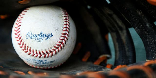A baseball sits inside a glove before a spring training game between the Miami Marlins and New York Mets on March 15, 2016, in Jupiter, Fla. (Getty Images)