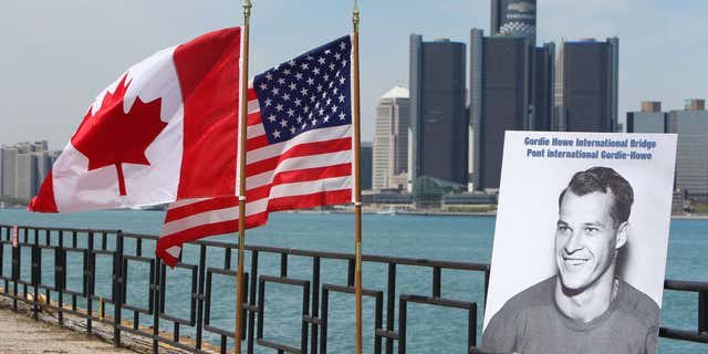 May 14, 2015: A photograph of Gordie Howe is displayed on the riverfront after a news conference.