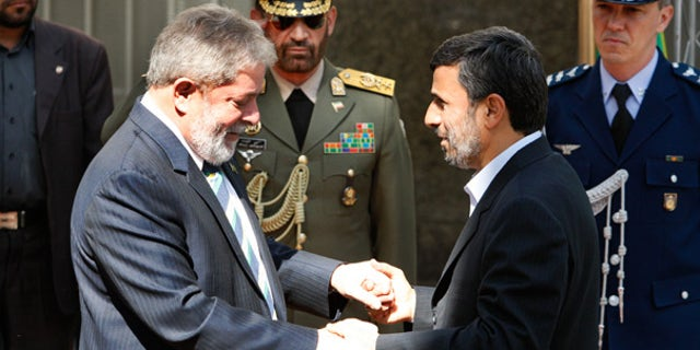 May 16: Iranian President Mahmoud Ahmadinejad, right, welcomes Brazilian President Luiz Inacio Lula da Silva in Tehran.