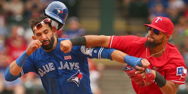 Toronto Blue Jays Jose Bautista (19) gets hit by Texas Rangers second baseman Rougned Odor (12) after Bautista slid into second in the 8th inning at Globe Life Park on May 15, 2016 in Arlington, Texas. The Rangers won 7-6. (Richard W. Rodriguez/Fort Worth Star-Telegram/TNS),Toronto Blue Jays Jose Bautista (19) gets hit by Texas Rangers second baseman Rougned Odor (12) after Bautista slid into second in the 8th inning at Globe Life Park on May 15, 2016 in Arlington, Texas. The Rangers won 7-6. (Richard W. Rodriguez/Fort Worth Star-Telegram/TNS via Getty Images)