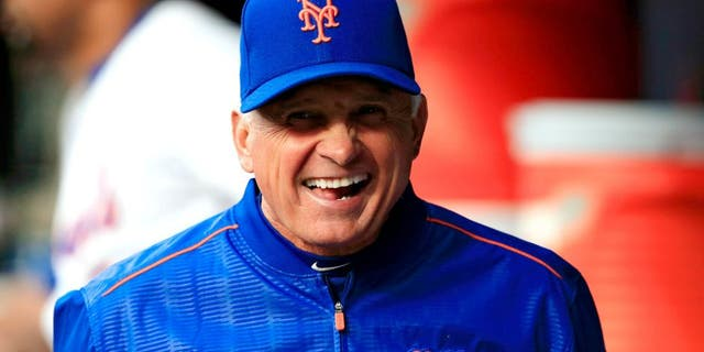 NEW YORK, NY - APRIL 21: Terry Collins #10 of the New York Mets laughs in the dugout prior to a game against the Atlanta Braves at Citi Field on April 21, 2015 in the Flushing neighborhood of the Queens borough of New York City. (Photo by Alex Trautwig/Getty Images)