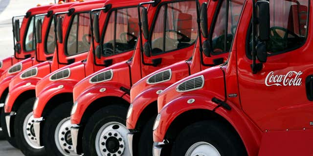 Oct. 26, 2006: Coca-Cola supply trucks park in a distribution center in Caracas.