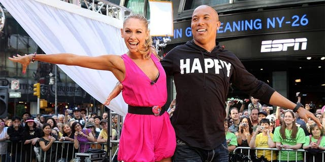 """NEW YORK, NY - MAY 25: Dancing with the Stars champions Kym Johnson and Hines Ward perform during ABC's """"Good Morning America"""" on Military Island in Times Square on May 25, 2011 in New York City. (Photo by Taylor Hill/Getty Images)"""