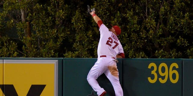 ANAHEIM, CA - SEPTEMBER 26: Mike Trout #27 of the Los Angeles Angels of Anaheim makes a catch high over the wall to rob Jesus Montero of the Seattle Mariners of what would have been a three-run home run during the fourth inning of the game against the Seattle Mariners at Angel Stadium of Anaheim on September 26, 2015 in Anaheim, California. (Photo by Matt Brown/Angels Baseball LP/Getty Images)