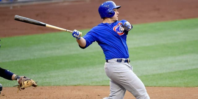 SAN DIEGO, CA - MAY 21: Miguel Montero #47 of the Chicago Cubs hits a double during the third inning of a baseball game against the San Diego Padres at Petco Park May 21, 2015 in San Diego, California. (Photo by Denis Poroy/Getty Images)