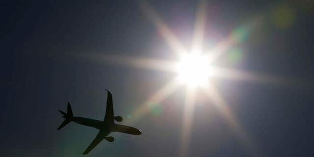 A flight witnessed an unmanned aircraft near the airport.