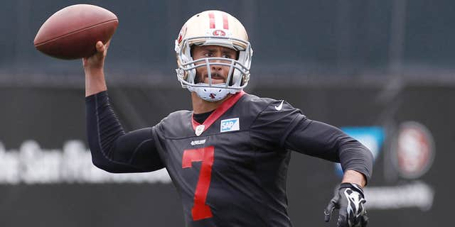 May 21, 2015: San Francisco 49ers quarterback Colin Kaepernick throws the ball during NFL football practice.