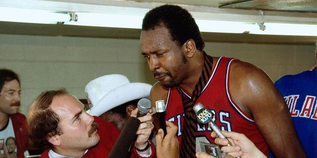Moses Malone, an NBA champion with the Philadelphia 76ers, comes in as the No. 20 player. (Photo by Andrew D. Bernstein/ NBAE/ Getty Images)