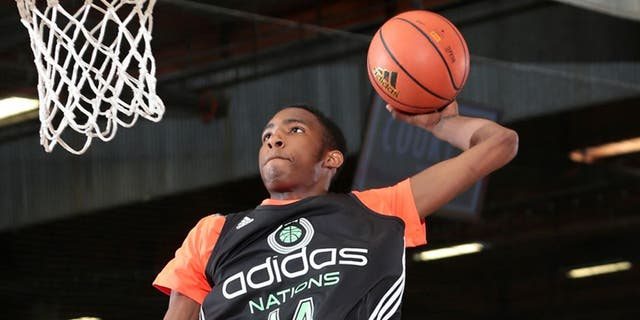GARDEN GROVE, CA - AUGUST 1: Derrick Jones #14 with the dunk during the 2014 adidas Nations on August 1, 2014 at Next Level Sports Complex in Garden Grove, California. (Photo by Kelly Kline/Getty Images)