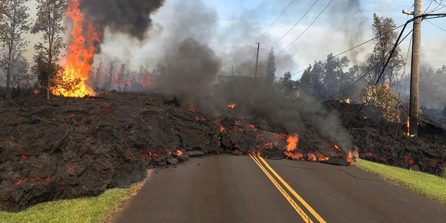 Lava from Fissure 7 slowly advances to the northeast on Hookapu Street in the Leilani Estates subdivision in Pahoa, Hawaii, May 5, 2018.
