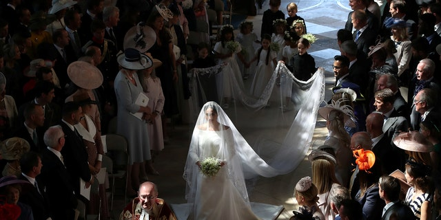 Meghan Markle walked down the aisle carrying a small bouquet of forget me not flowers picked my Prince Harry to honor Diana.