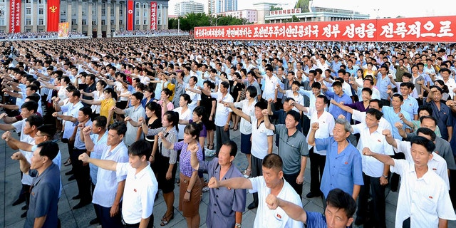 People participate in a Pyongyang city mass rally held at Kim Il Sung Square on August 9, 2017, to fully support the statement of the Democratic People's Republic of Korea (DPRK) government in this photo released on August 10, 2017 by North Korea's Korean Central News Agency (KCNA) in Pyongyang.