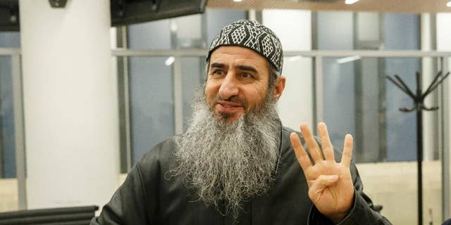 FILE - This is a Friday, Nov. 13, 2015 file photo of Najmaddin Faraj Ahmad, also known as Mullah Krekar, waves as he walks into court in Oslo. Norway's Supreme Court Wednesday Nov. 23, 2016  refused to hear an appeal by  Najmaddin Faraj Ahmada radical Iraqi-born cleric who is trying to fight extradition to Italy, which suspects him of enticing recruits to fight in Iraq and Syria. The decision  paves the way for Norway to hand over the cleric, to Italian authorities. (Cornelius Poppe / NTB scanpix, File via AP)