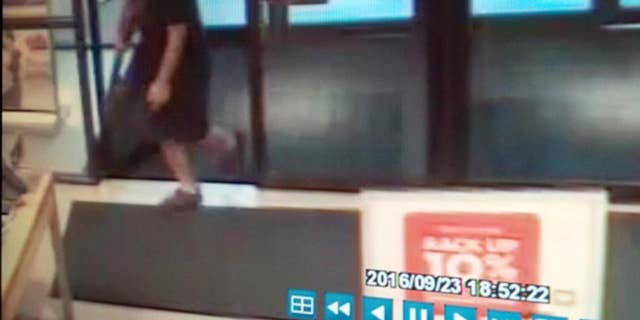 A frame from a surveillance video showing a man alleged to be Arcan Cetin during the Cascade Mall shooting.
