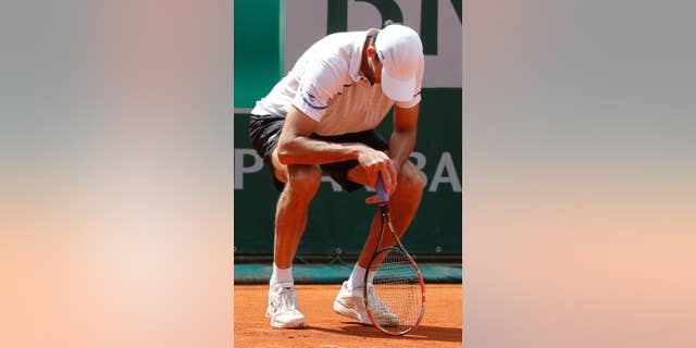 Croatia's Ivo Karlovic looks down as he plays South Africa's Kevin Anderson during their third round match of  the French Open tennis tournament at the Roland Garros stadium, in Paris, France, Saturday, May 31, 2014. (AP Photo/Michel Euler)