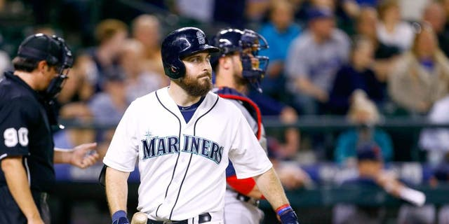 May 28, 2015; Seattle, WA, USA; Seattle Mariners left fielder Dustin Ackley (13) walks back to the dugout after striking out during the ninth inning of a 5-3 loss to the Cleveland Indians at Safeco Field. Mandatory Credit: Joe Nicholson-USA TODAY Sports