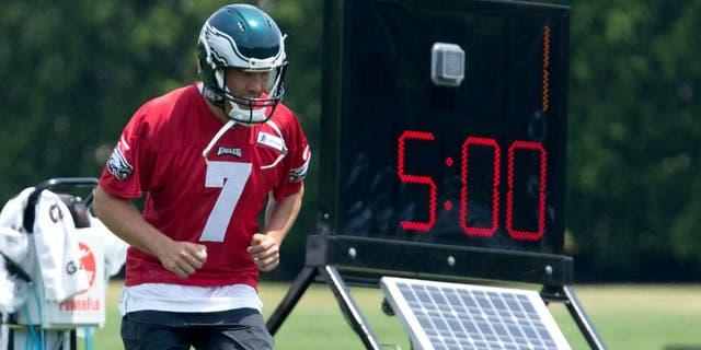 May 28, 2015; Philadelphia, PA, USA; Philadelphia Eagles quarterback Sam Bradford (7) loosens up during OTA's at the NovaCare Complex. Mandatory Credit: Bill Streicher-USA TODAY Sports