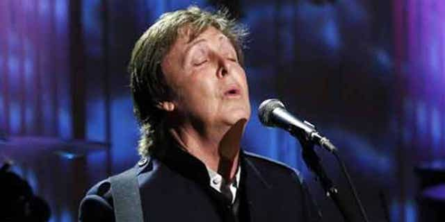 """June 2: Paul McCartney performs """"Michelle"""" in the East Room of the White House while being honored by President Obama. Obama awarded McCartney the 3rd Gershwin Prize for Popular Song from the Library of Congress."""