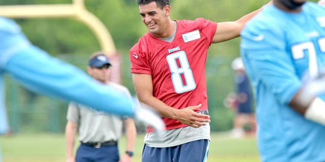 May 15, 2015; Nashville, TN, USA; Tennessee Titans first round draft pick quarterback Marcus Mariota (8) works out during minicamp at Saint Thomas Sports Park. Mandatory Credit: Jim Brown-USA TODAY Sports